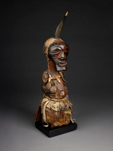 Power Figure (Nkishi). Songye people, Democratic Republic of Congo, Lubao Territory, early 20th century. Wood, hide, horn, metal, fiber, glass beads. 35 × 7 1/2 × 8 inches. Museum purchase with funds provided by the Birmingham City Council through the Birmingham Arts Commission, and the Endowed Fund for Acquisitions, 1989.64.
